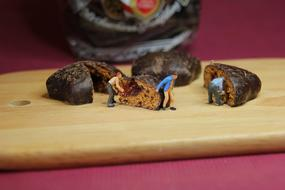 miniature men bearing Advent Chocolate Pastries