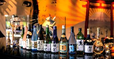 row of alcohol Drinks in Bottles in sake bar