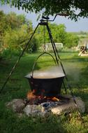 Soup Stewing in pot above campfire