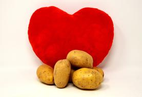 young potatoes on a red heart background