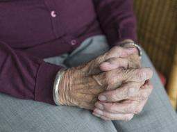 hands of an elderly woman on her knees