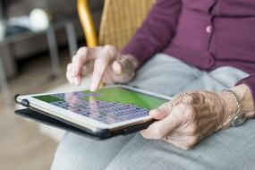 elderly woman holding tablet