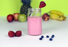 photo of pink smoothie and fruits on the table