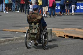 photo of a man on a wheelchair