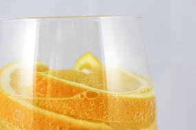 oranges in mineral water in a glass