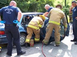lifeguards cut the car with hydraulic scissors