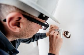 electrician fixing an outlet
