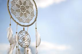 white dream catcher with feathers