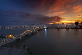 distant view of the bridge at dusk in vietnam