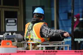 back view of male Construction Worker in blue hard hat