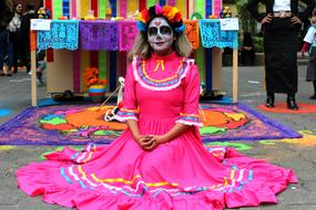woman in traditional dress in Mexican festival