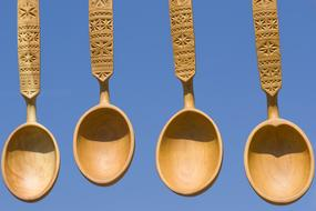 wooden spoons on a blue background