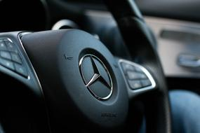 steering wheel of Mercedes close-up on blurred background
