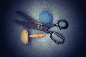 Old Sewing Scissors and blue yarn
