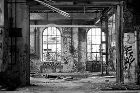 black and white photo of an old ward in an abandoned hospital