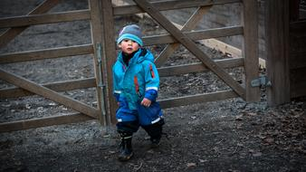 boy in blue winter suit