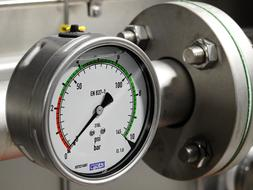 a pressure gauge on the pipe at the factory