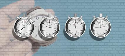 drawn four stopwatch on a brick wall background
