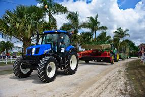 tractor and agricultural machinery on a street in Belize