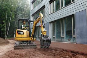 Mini excavator near new building