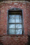 retro window on the brick facade