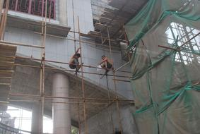 workers on Scaffolding Platform