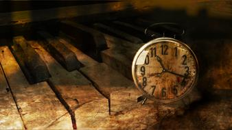 alarm clock on the background of old broken piano keys