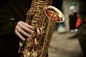 brilliant saxophone in the hands of a musician