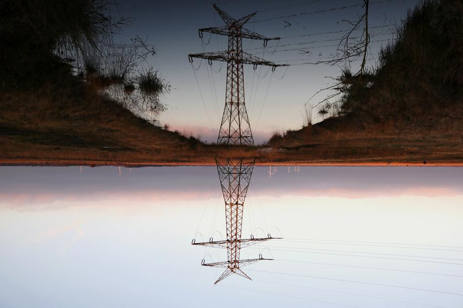 power line is reflected on the surface of the lake