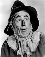 black and white photo of an artist in a scarecrow costume from a fairy tale The Wizard of Oz