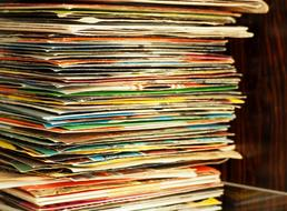 stack of vinyl records with weathered covers