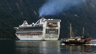 Cruise Ship on milford sound at coast, new zealand