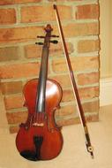 standing violin with bow