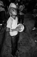 Child boy plays drum on Festival, Nepal