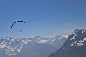 parachute soaring in mountains