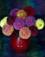 red Vase with dahlia Flowers