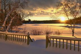 scenic Sunset in countryside at snowy winter, Landscape