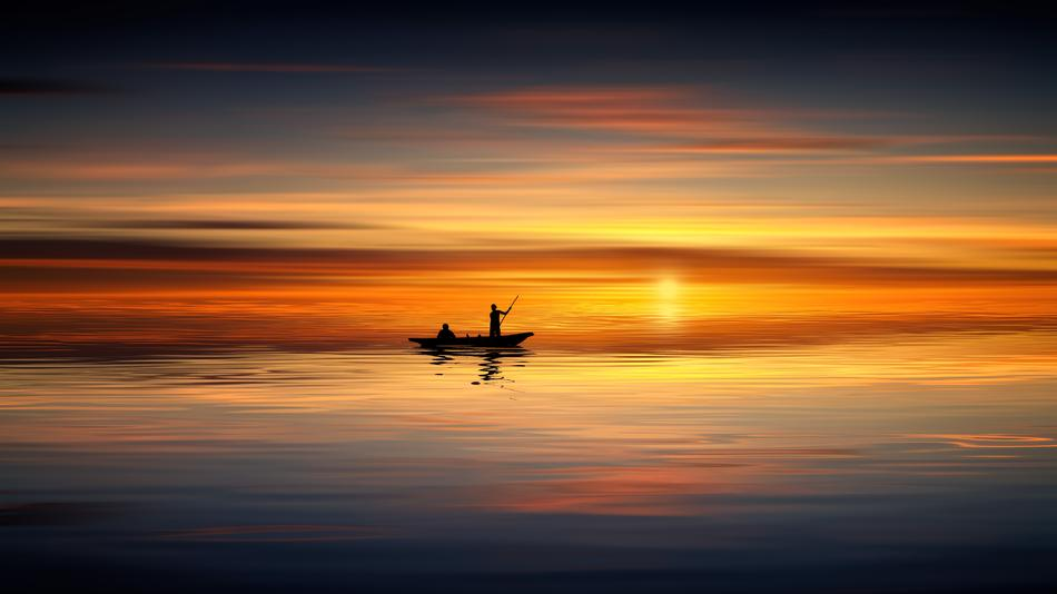 people in Boat on calm sea at sunset