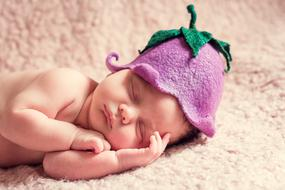 newborn in cute hat