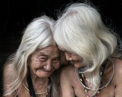 photo of two elderly asian girlfriends