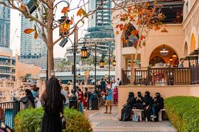 photo of people near a shopping center in Dubai