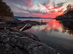 scenic sunset landscape with pink clouds above rocky coastline, Canada, British Columbia, Francis Point Provincial park