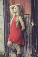 beautiful girl in red at old wooden wall
