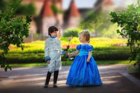 girl and boy in costumes of a princess and a prince
