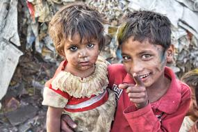poor brother and sister in a slum in India