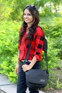 smiling long haired Girl in casual clothing outdoor
