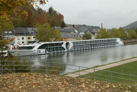 Cruise Ship at riverside in front of town, germany, saarburg