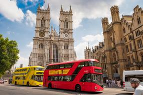 red and Yellow double-decker buses in historical center of city, uk, england, london