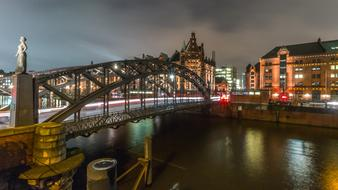 Bridge across channel in old city at night, germany, hamburg, speicherstadt