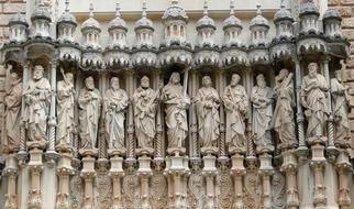 stone carved figures of saints on facade of Abbey of Montserrat, spain, barcelona